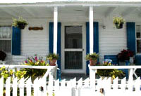 """porch of """"Auntie's House"""" Charles restored"""